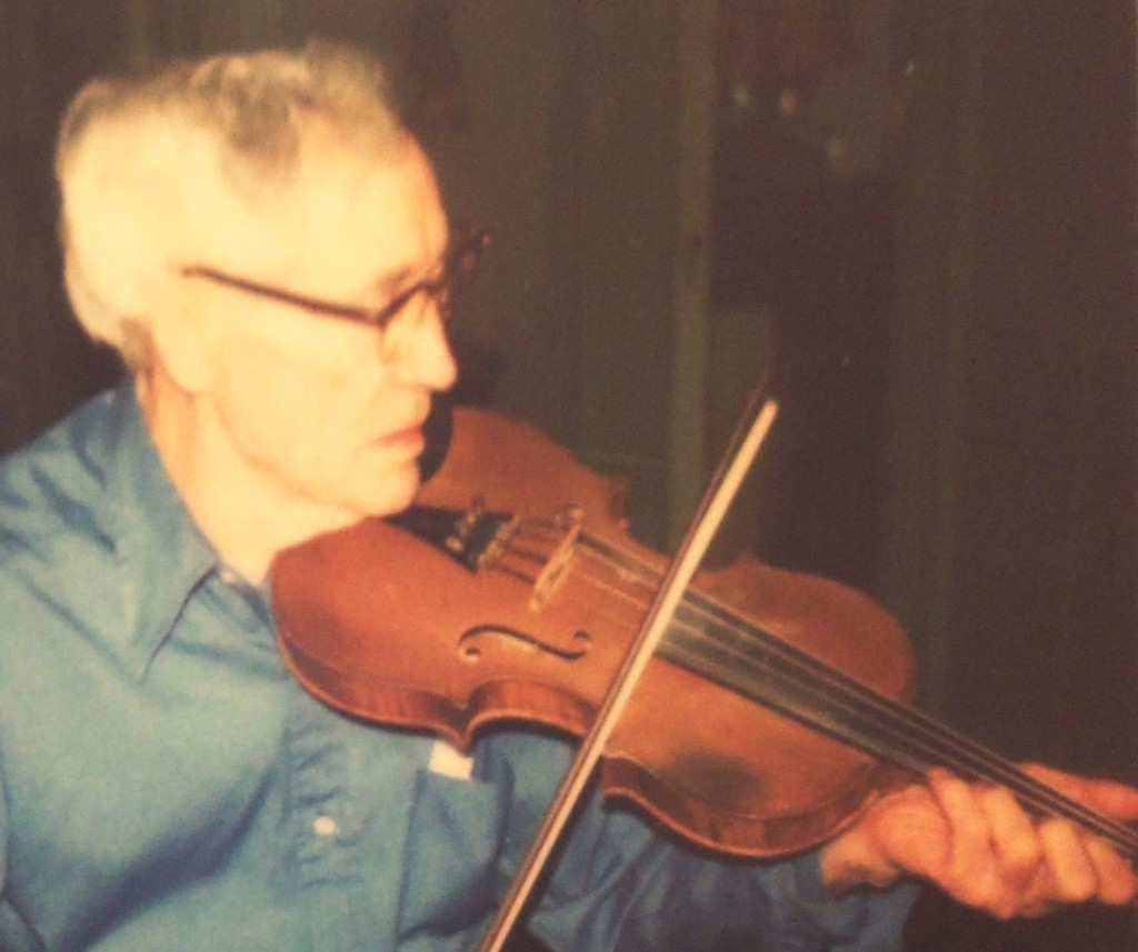 Tom Fuller playing his  fiddle